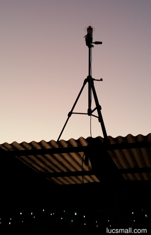 """A 16 radial spider antenna for ADSB mounted on a tripod, at sunset"""